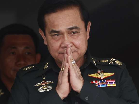 Thailand's newly appointed Prime Minister Prayuth Chan-ocha gestures in a traditional greeting during his to a unit of the Queen's Guard outside of Bangkok on Thursday.