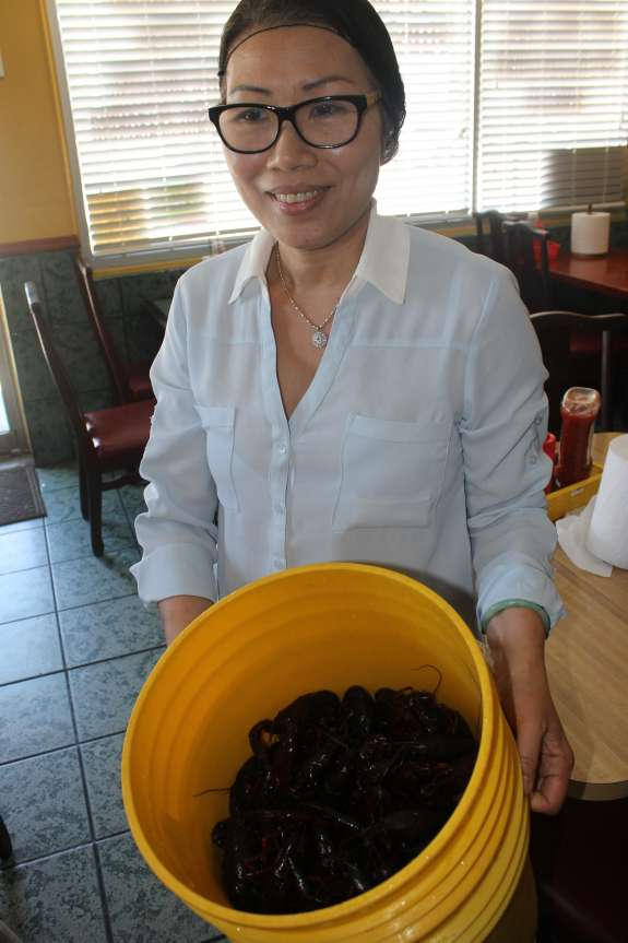 King Cajun owner Ha Nguyen brings out fresh Louisiana crawfish. She flies them in every morning.