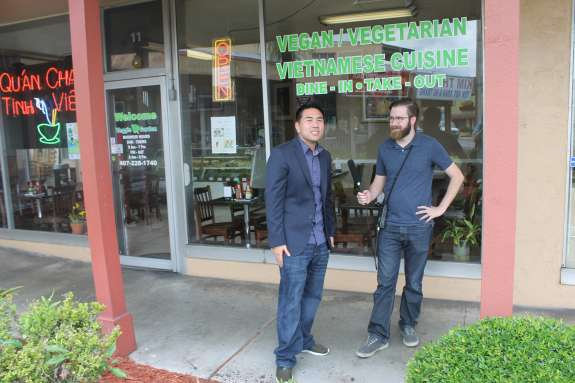 Ricky Ly and producer Brendan Byrne outside of Veggie Garden, a vegetarian and vegan Vietnamese restaurant.