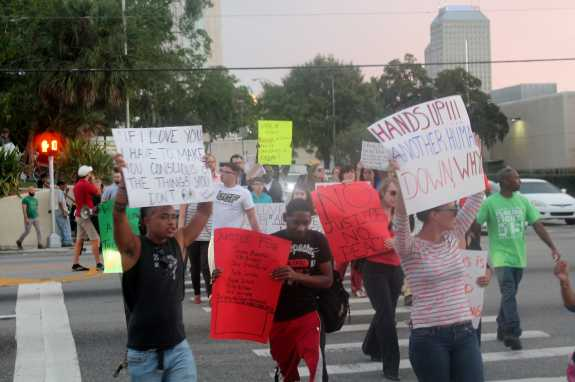 Protesters march at the intersection of Magnolia Avenue and Colonial Drive in downtown Orlando.
