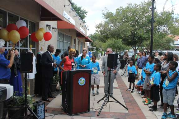 City Commissioner Regina Hill speaks at the ribbon cutting for a renovated commercial building in Parramore. Photo: Matthew Peddie, WMFE