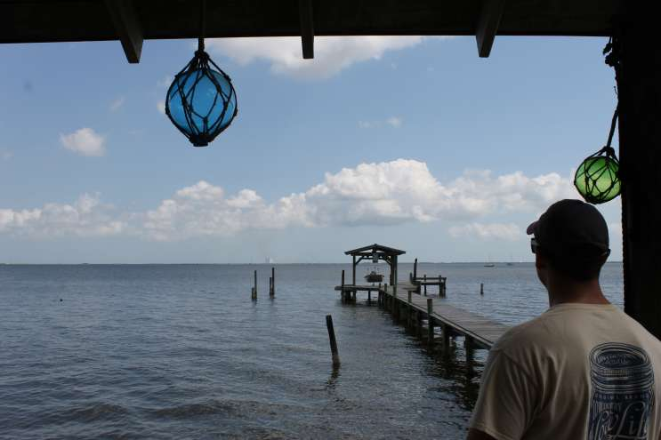 Brandon Burdine looks out across the Indian River Lagoon from the shore of his parents' house in Titusville. Photo: Matthew Peddie, WMFE