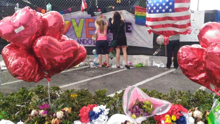 People write messages at the memorial outside the Pulse nightclub. Photo: Matthew Peddie, WMFE