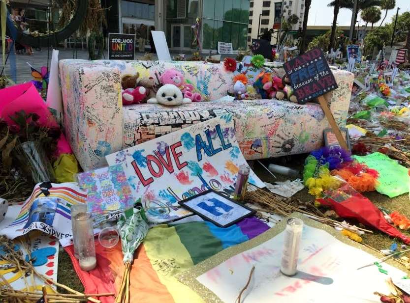 A trophy, Teddy bears, heart-shaped wreaths, and candles are just a few of the thousands of items mourners placed at a memorial in downtown Orlando in the weeks following the Pulse nightclub shooting. Photo: Renata Sago.