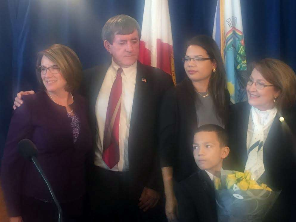 L to R: Newly sworn-in Orange County commissioners Betsy VanderLey, Pete Clarke, Emily Bonilla, her son, and Mayor Teresa Jacobs. Photo: WMFE.