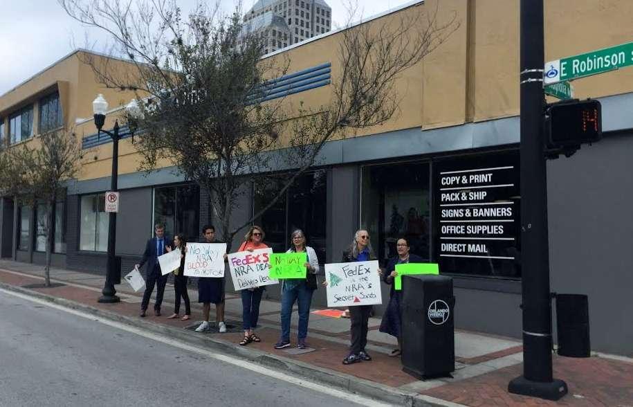 Gun reform advocates in Orlando say FedEx is helping the National Rifle Association grow its membership. Photo: WMFE.