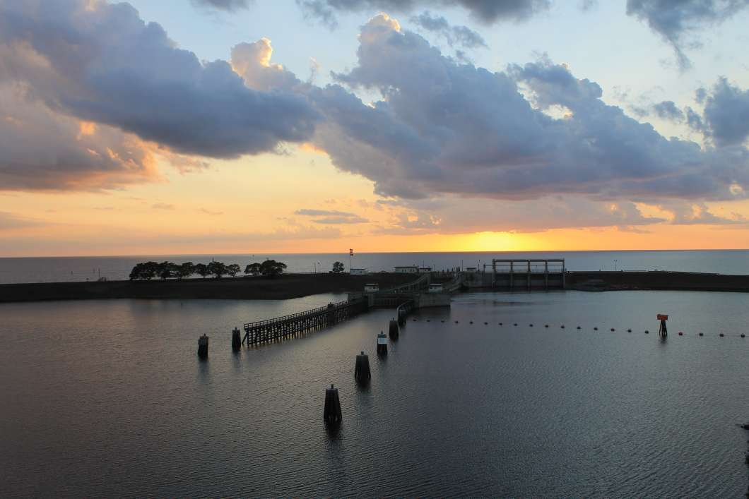 The sun sets behind the lock and dam on Lake Okeechobee and the St. Lucie River. Photo by Amy Green