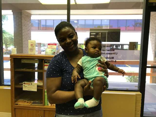 Diana Saddler, and her five-month daughter, Anastasia at the Easy Access Clinic in Pine Hills. Photo: Danielle Prieur