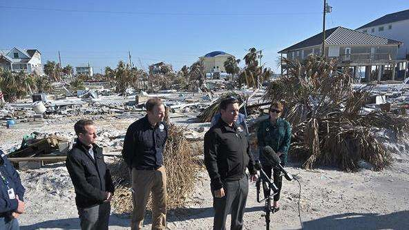 Gov. Ron DeSantis tours the destruction from Hurricane Michael in Mexico Beach in January. photo: