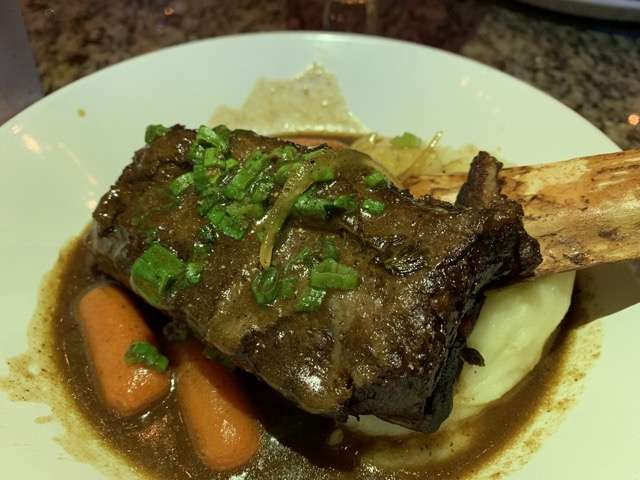 """For my entree I selected that Short Rib Carbonnade, described as a """"hearty Belgian dish"""" with a large braised rib with a gravy infused with beer, mustard and gingerbread.  Photo: Scott Joseph"""