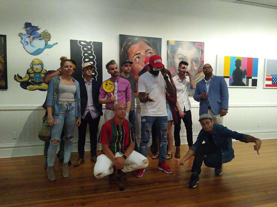 Some of the B-Side Artists at CityArts Factory, including SKIP (center left, holding the battered-looking smiley face). Photo courtesy of B-Side Artists' Facebook page