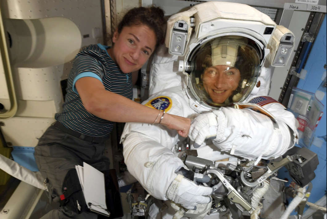 Astronauts Christina Koch (right) and Jessica Meir pose for a photo on the International Space Station on Oct. 4. NASA moved up the first all-female spacewalk because of a power system failure at the space station.