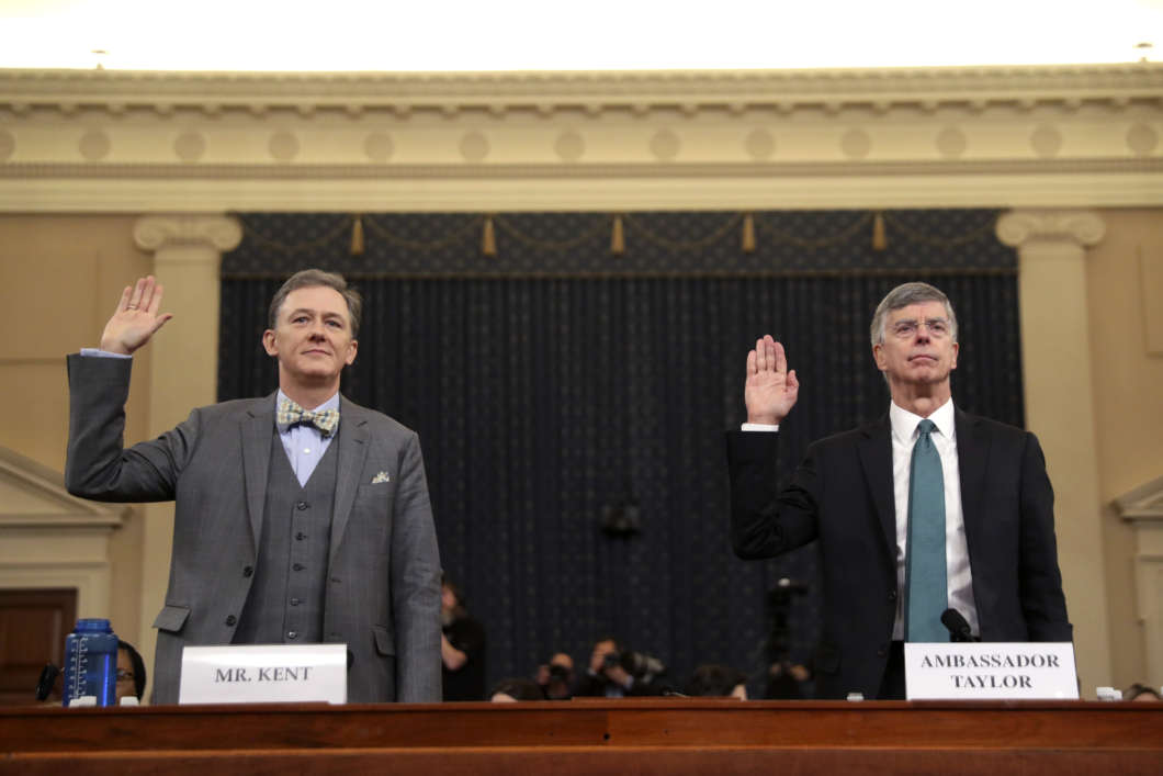 Top State Department official George Kent (left) and acting U.S. Ambassador to Ukraine William Taylor are sworn in to testify during the first public Trump impeachment hearing on Wednesday.