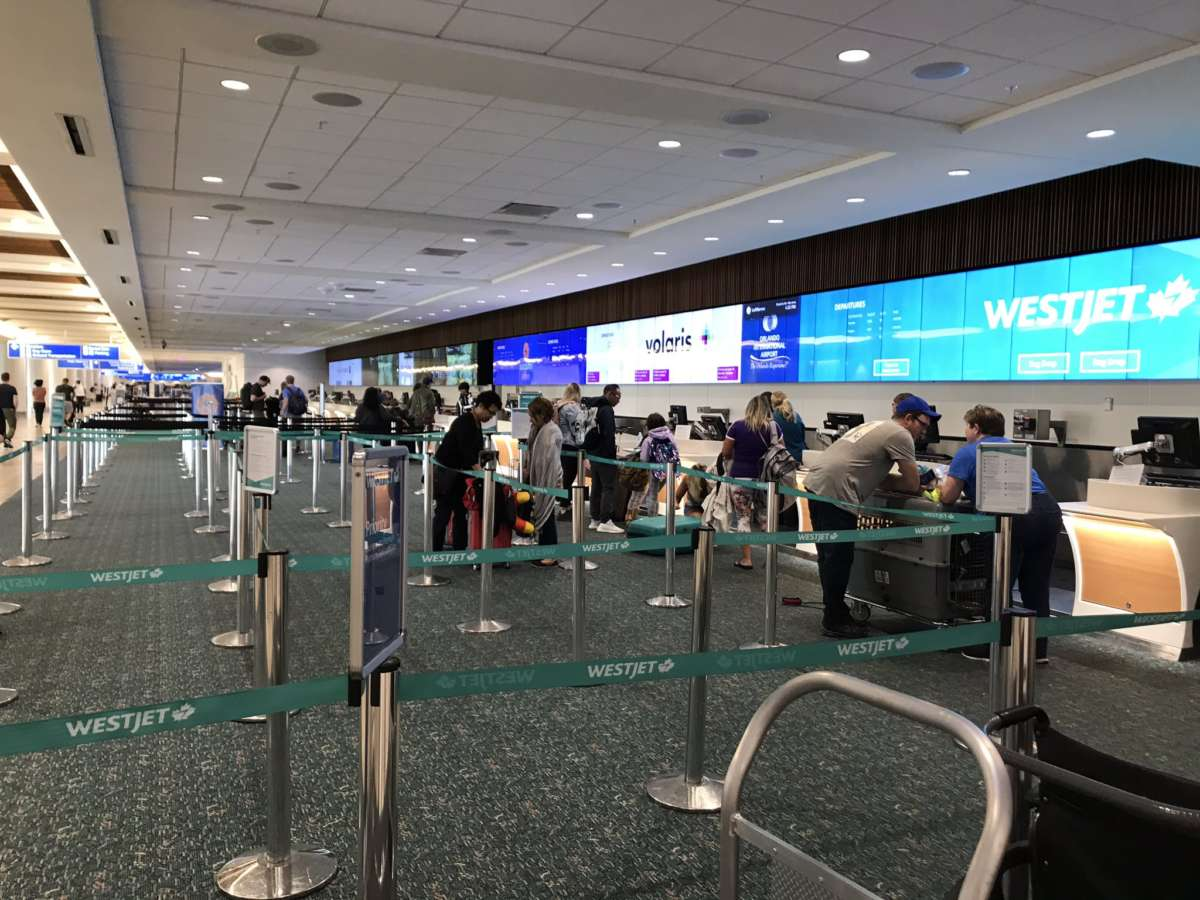 People wait in line at Orlando International Airport. Photo: Danielle Prieur