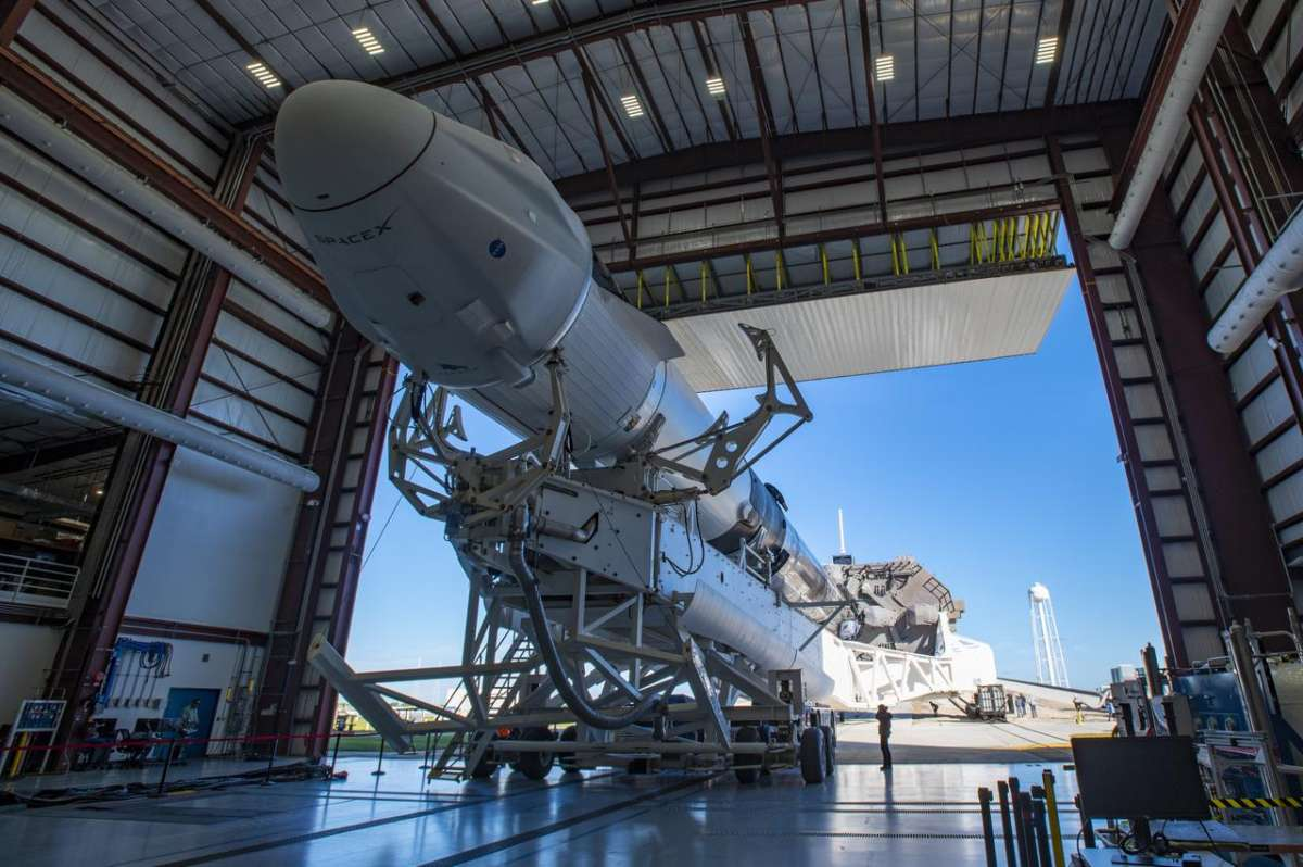 A SpaceX Falcon 9 rocket, topped with the upgraded version of the Cargo Dragon spacecraft, is seen inside the company's hangar at NASA's Kennedy Space Center in Florida on Dec. 2, 2020, prior to being rolled out to the launch pad in preparation for the 21st Commercial Resupply Services (CRS-21) launch. Photo: NASA