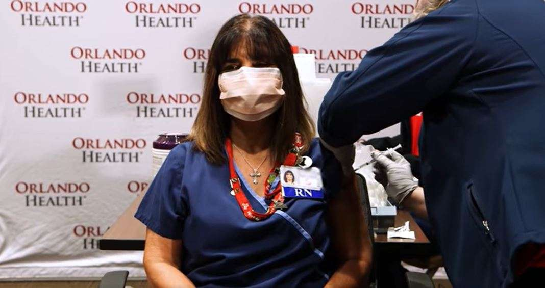 A nurse at Orlando Health receives the first dose of a coronavirus vaccine. Photo courtesy of Orlando Health.