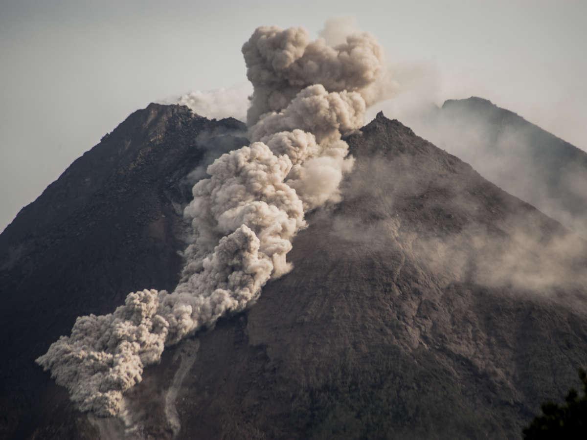 Indonesian volcano erupts, sending river of lava flowing