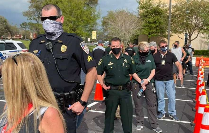 """Law enforcement officers got vaccinated at the Valencia College – West Campus FEMA site during a """"dress rehearsal."""" Photo: Orange County Sheriff's Office via Facebook"""