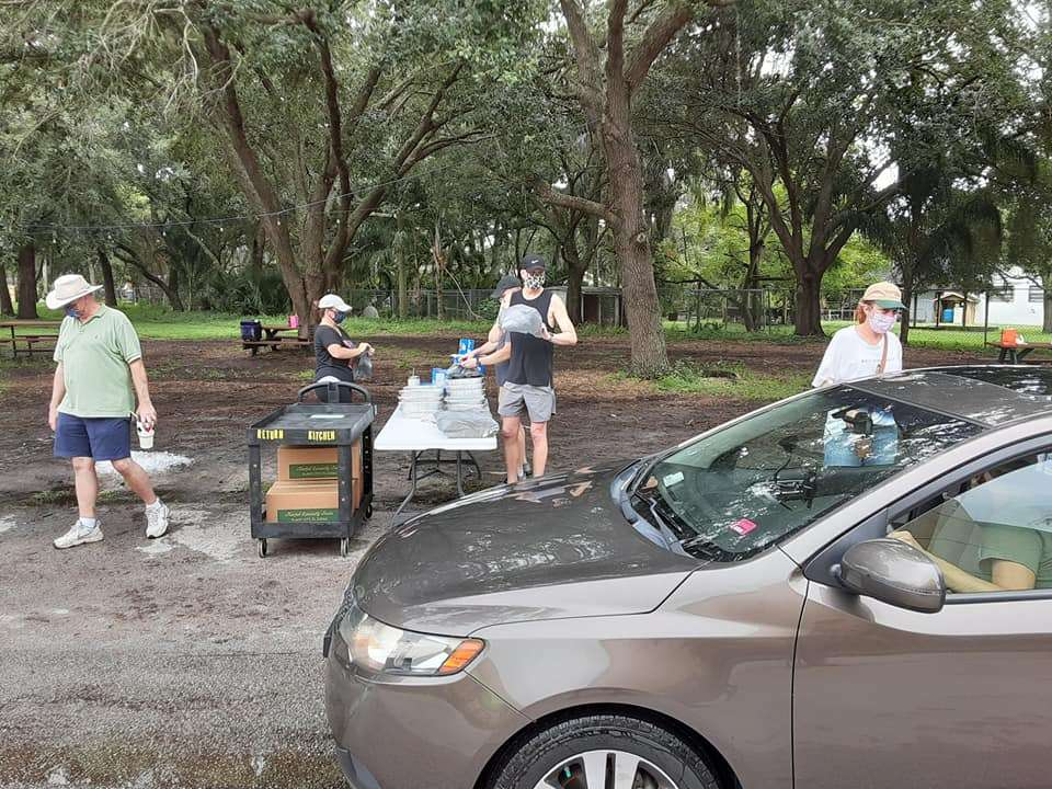 Volunteers distribute food to cars at St. Luke's United Methodist Church. Photo: Cami Miller