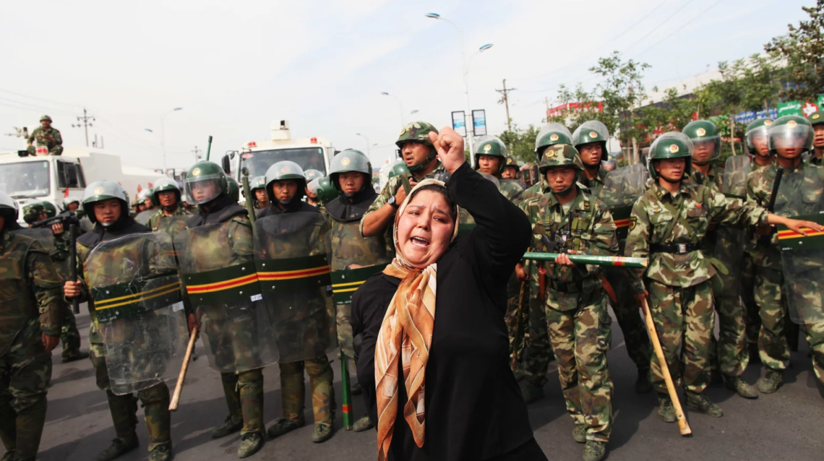 A Uyghur woman protests the 2009 detainment of Uyghur citizens following ethnic unrest in the Xinjiang region, China.