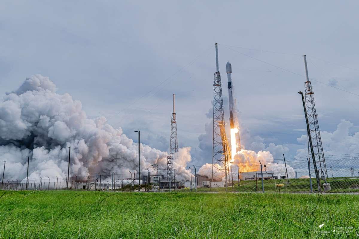 A SpaceX Falcon 9 rocket takes off, leaving behind a cloud of smoke. Photo: Matt Cutshall