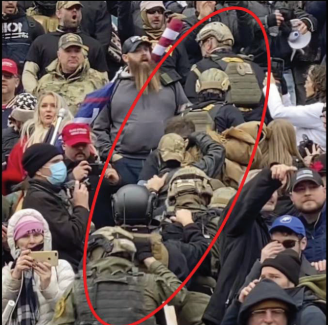 """This altered image provided by the FBI shows members of the Oath Keepers in a """"stack"""" formation on the U.S. Capitol steps on Jan. 6."""