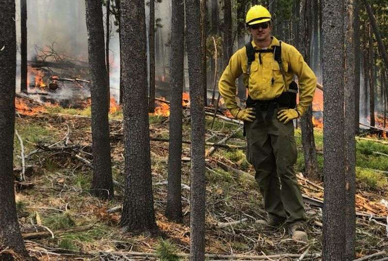 Seminole County firefighter Joshua Evertsen takes a break to pose for a photo in western Montana while battling a brush fire. Photo courtesy Seminole County Fire Department