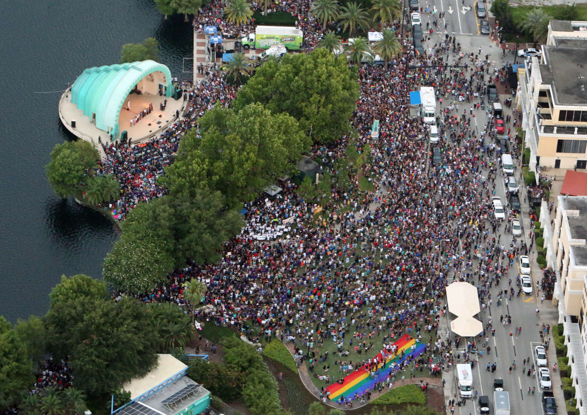 Aerial view of the out pouring of people attending a Pulse nightclub shooting vigil Sunday, June 19, 2016. Orlando City officials are expecting about 20,000 people to attend a vigil at Lake Eola on Sunday night. (Red Huber/Staff Photographer)